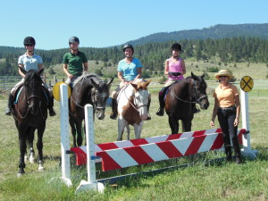 Carrie Allen of In Motion Sport Horses, LLC teaching a jumping clinic